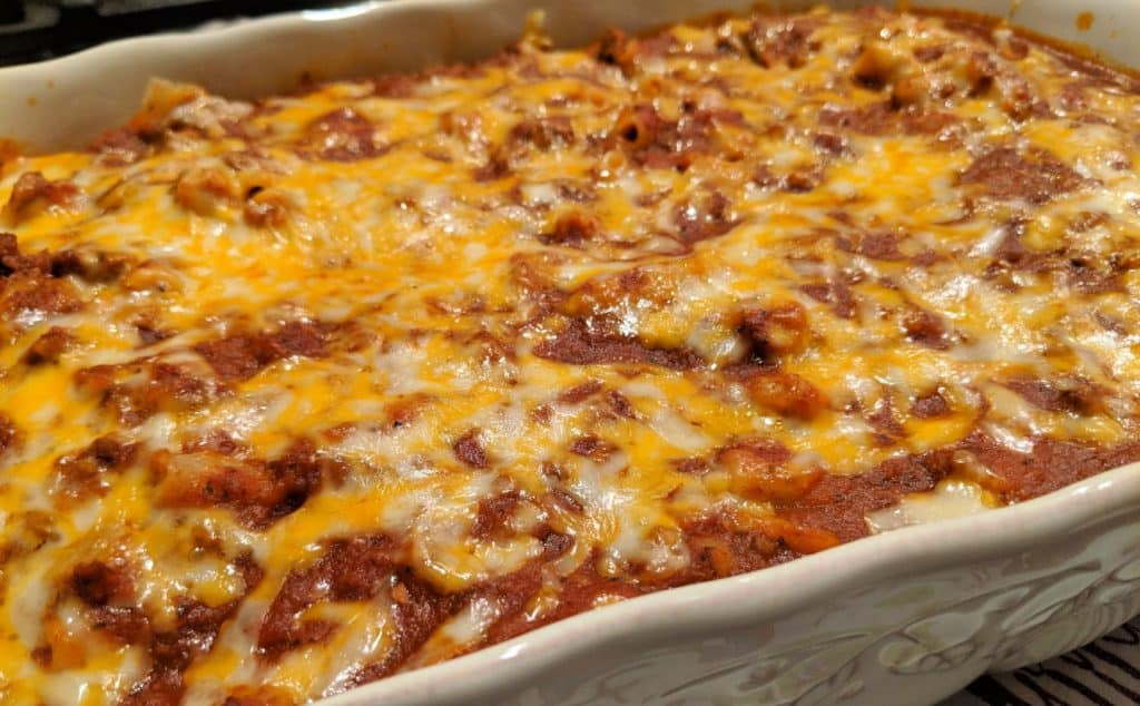 baked lasagna with cheese in casserole dish