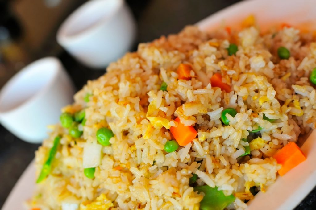 fried rice with vegetables and egg on white plate, easy dinner