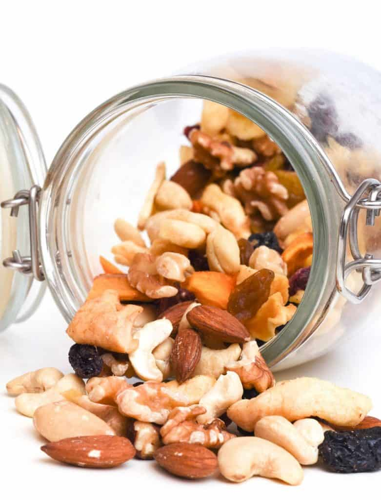 nut trail mix spilling from overturned jar