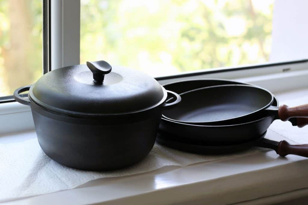 cast iron cookware on white window ledge