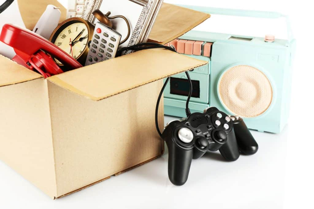 box of stuff, game controls, old clock, clutter