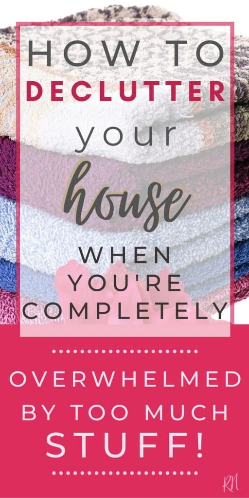 stack of towels with overlay text how to declutter hour house when you are overwhelmed by too much stuff